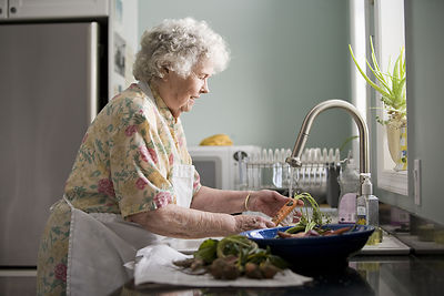 Help yourself! Whenever Mrs. Ida Aickman is working in her kitchen, it's a wonderful time to harvest her landscaping.